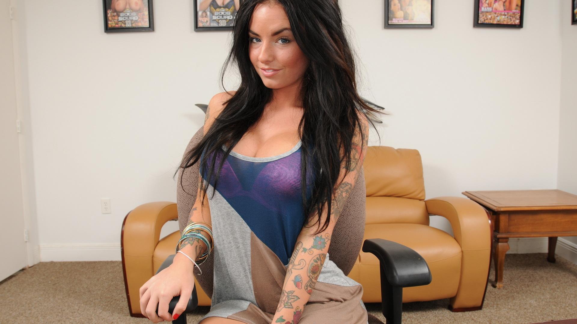 tattooed brunette in black fishnet is eating jizz with appetite  141007