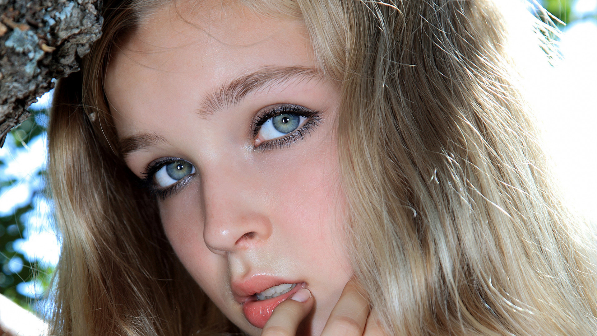 Close up side profile of pretty blonde teen by dina marie giangregorio