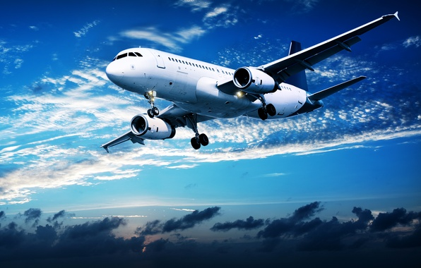Photo wallpaper clouds, flight, sunset, the plane, in the sky, passenger, airliner