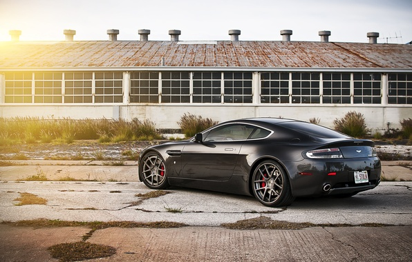 Picture the sun, black, Aston Martin, Vantage, hangar, Aston Martin, black, Blik, the rear part