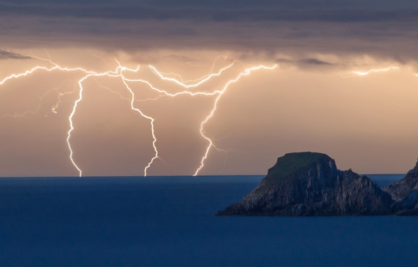Picture sea, clouds, rocks, lightning