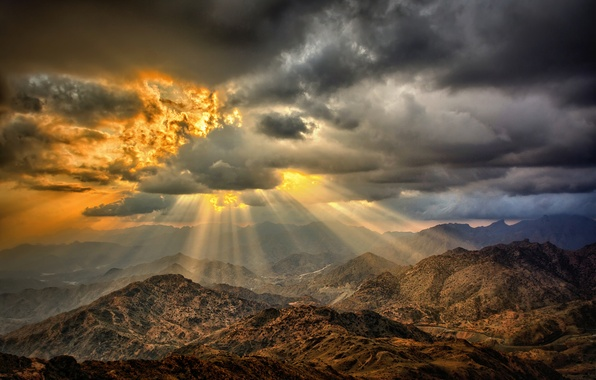 Picture the sun, clouds, mountains, fire, desert