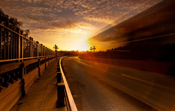 Picture road, the sky, the sun, light, the city, glare, the fence, excerpt