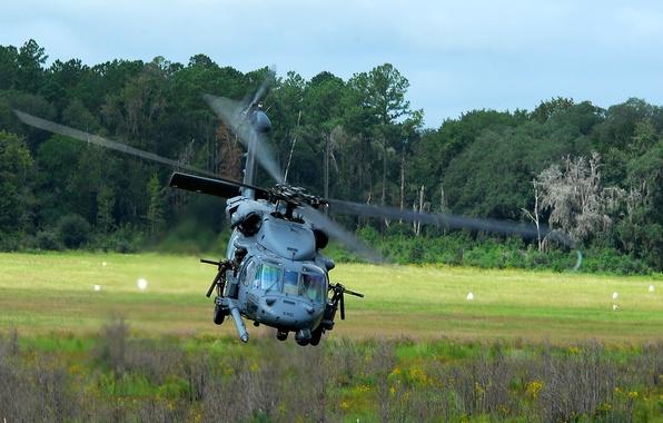 Picture flight, machine gun, sh-60 seahawk