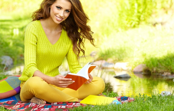 Picture grass, girl, smile, pond, book, brown hair, plaid, sitting