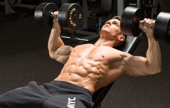 Picture men, gym, dumbbells, weightlifter