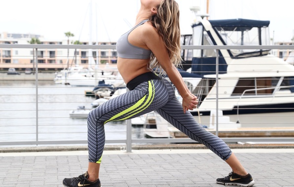 Picture woman, outdoors, physical activity, elongation