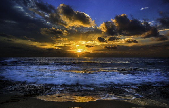 Picture the sun, sunset, surf, the Pacific ocean