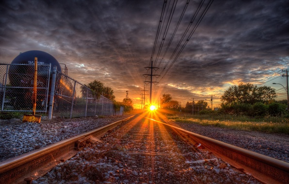 Picture the way, rails, sleepers, the sun