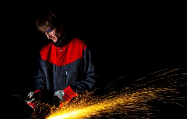 Picture metal, sparks, grinder, metallurgical worker