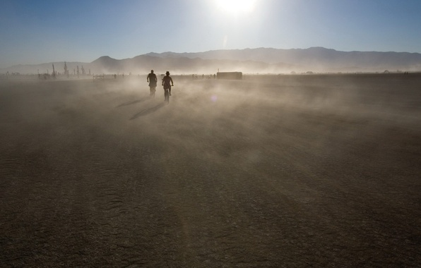 Picture the sun, mountains, movement, dust
