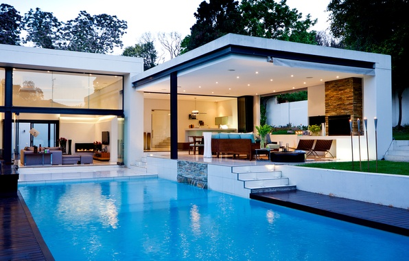 Picture water, house, fire, chairs, interior, pool, lighting, tables, fireplace, sofas