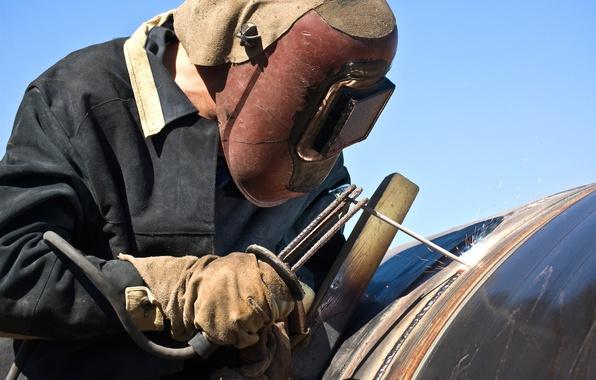 Picture welder, personal protective equipment, laborer, worker