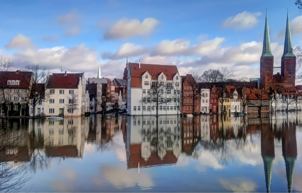 Picture the sky, water, clouds, trees, reflection, building, Europe, houses, town