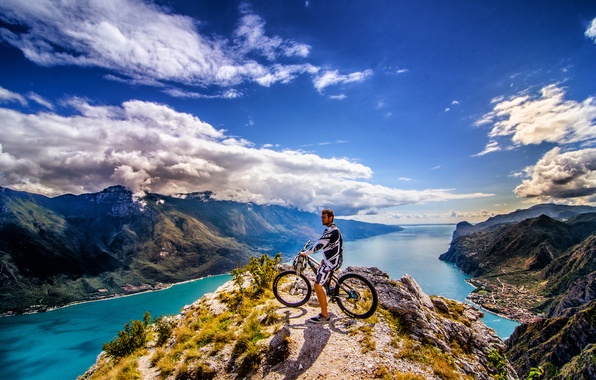 Picture the sky, clouds, mountains, the city, rider, peak, solar, mountain bike, the fjord, extreme sports