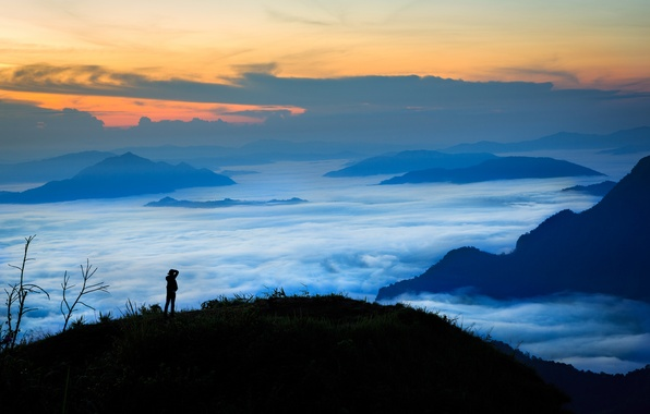 Picture the sky, clouds, sunset, mountains, fog, people, silhouette