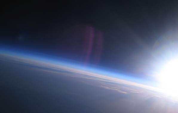 Picture the sky, the sun, clouds, earth, planet, the atmosphere