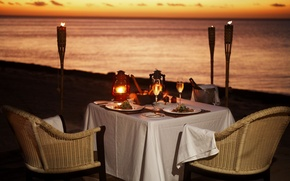 Picture beach, the ocean, wine, romance, the evening, torches, dinner