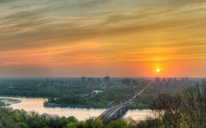 Picture the sun, trees, river, spring, Ukraine, Kiev, Dnepr, city view, Rusanivsky bridge