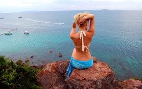 Picture girl, nature, rock, the ocean, Thailand, in swimsuit, looking forward, sitting on a rock