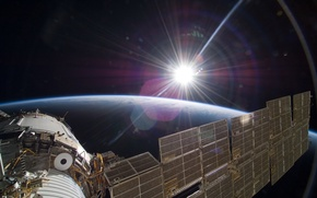 Picture the sun, light, earth, The international space station