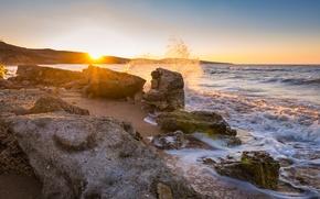 Picture sea, the sun, stones, dawn