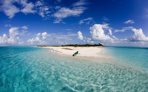 Picture the ocean, boat, island, Bahamas