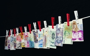 Wallpaper rope, bills, clothespins, money