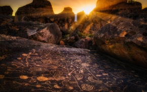 Picture the sun, rays, stones, rocks, drawings