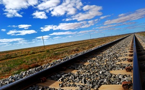 Picture the sky, clouds, the steppe, rails, railroad, sleepers, crushed stone