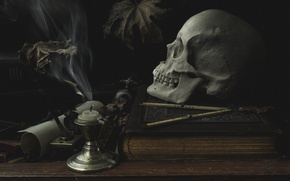 Picture table, skull, candle, book