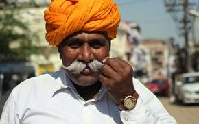 Picture mustache, turban, clock, man