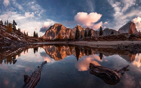 Picture the sky, clouds, mountains, reflection.