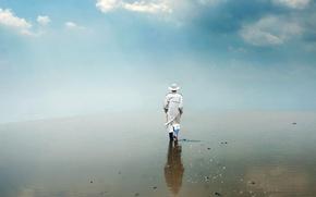 Picture man, Salar de uyuni, walking on water