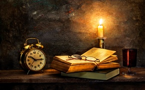 Picture watch, candle, old books, Time to turn in