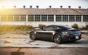 Picture the sun, black, Aston Martin, Vantage, hangar, Aston Martin, black, Blik, the rear part