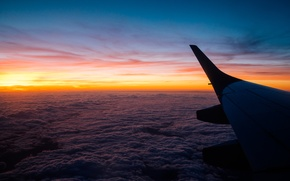 Picture the sky, the plane, wing, horizon