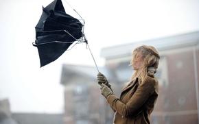 Picture girl, the city, the wind, umbrella