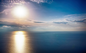 Picture sea, the sky, the sun, clouds
