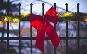 Picture red, garland, rods, holidays, winter, fence, lights, the fence, bow