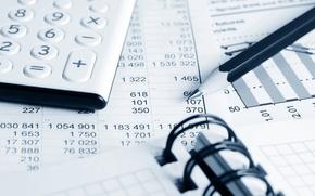 Picture paper, pens, economy, calculator, finance costs