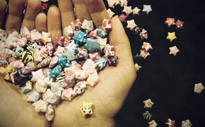 Picture heart, stars, her hands, wrappers