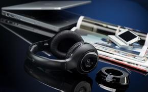 Picture table, headphones, phone, laptop, magazines