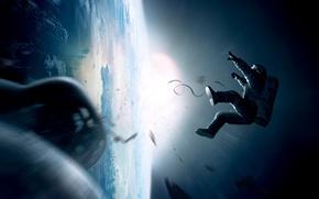 Picture the sun, astronaut, earth, gravity, Gravity