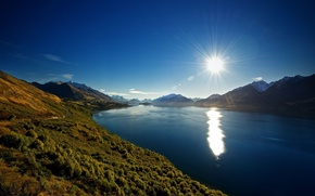 Picture the sun, mountains, river
