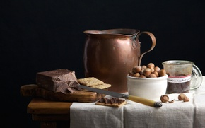 Picture table, chocolate, cookies, knife, Board, pitcher, nuts, still life