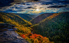 Picture forest, the sky, the sun, clouds, rays, sunset, mountains, clouds, river, rocks