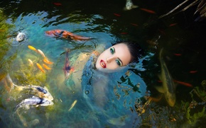 Picture girl, fish, in the water, Fish girl in a pond