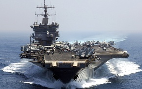 Picture the ocean, fighters, deck, Enterprise, with nuclear power, First aircraft carrier, the number CVN-65, the …