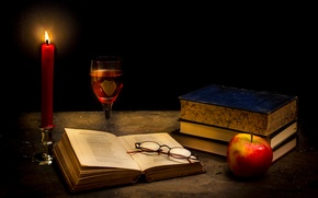 Picture glass, books, Apple, candle, glasses, Tranquillity in the dark